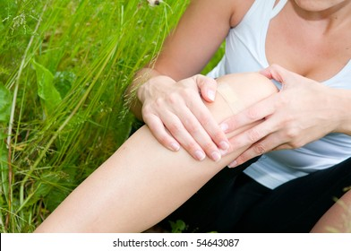 young woman with foot trauma in  field.