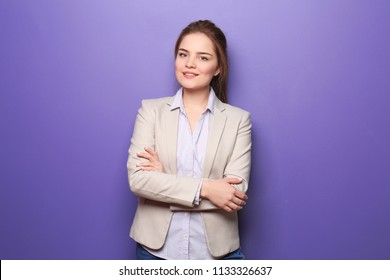Young woman in formal clothes on color background