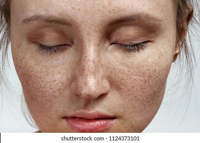young woman with a freckles natural beauty makeup look closeup portrait