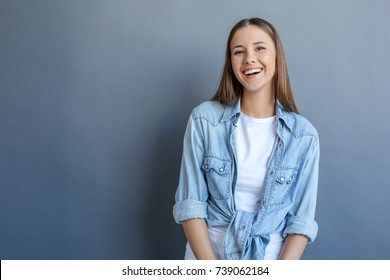 Young woman free style isolated on grey