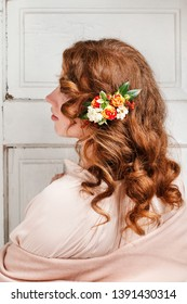 Young woman with fresh flowers in her hair.