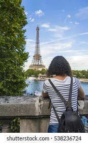Young woman in front of the Eiffel Tower in Paris