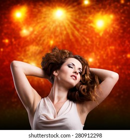 young woman in front of a firework background