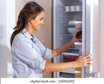 Young woman in front of the fridge