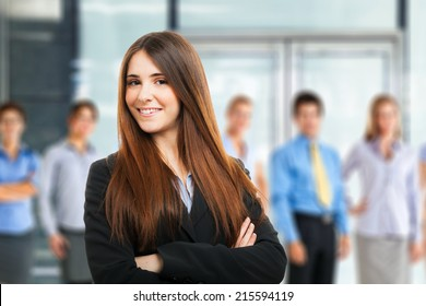 Young woman in front of a group of people