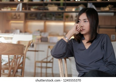 young woman frowning trying to remember important information, thoughtful girl , business thinking of her plans