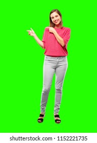 young woman full body. smiling and pointing to the side with both hands, towards the place where the publicist may show a concept.