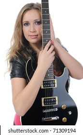 young woman in a full-length with a black guitar in his hand. Isolated on white background