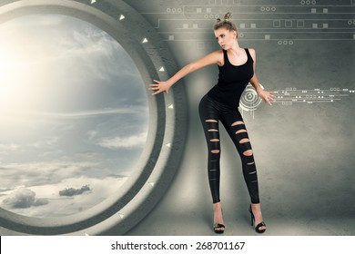 Young woman in futuristic interior playing science fiction crime scene