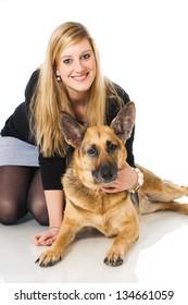 Young woman with german shepherd dog