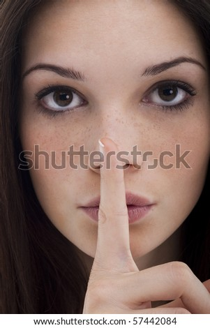 Young woman gesture for silence, full frame