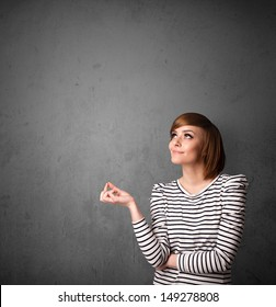 Young woman gesturing with empty space