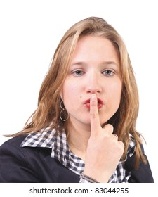 Young woman gesturing silence with finger on mouth