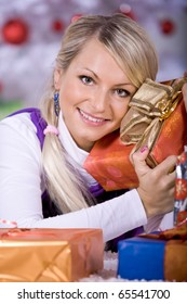 a young woman geting the Christmas gift