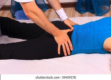 Young woman gets lower back massage