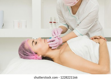 Young woman getting cosmetic injection in beauty clinic