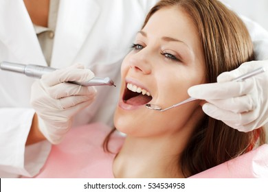 Young woman getting dental treatment.