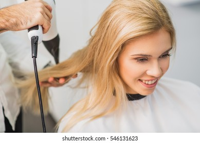 Young woman is getting haircut