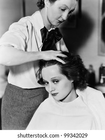 Young woman getting her hair done in a hair salon