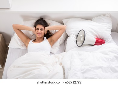 Young Woman Is Getting Irritated With Head Med Snoring Like Megaphone