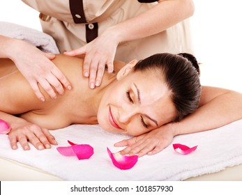Young woman getting massage in spa . Isolated.