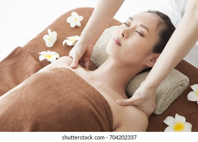 Young woman getting a massage in spa center.