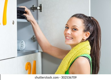 Young woman is getting ready for fitness training