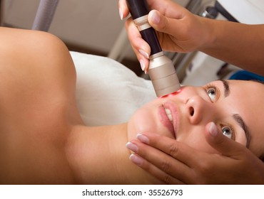 Young woman getting skin cleaning at beauty salon (shallow dof)