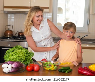 Young woman and girl making fresh vegetable salad. Healthy domestic food concept. Mother and daughter cooking together, help children to parents.