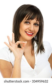 Young woman giving OK sign, isolated on white background