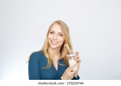 a young woman with a glass of milk. isolated on white.