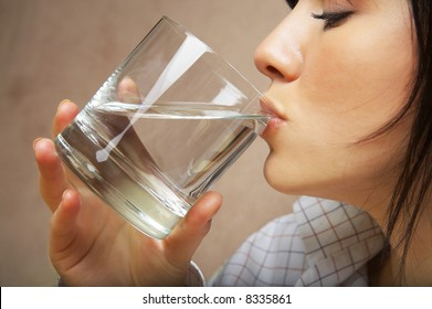 young woman with glass of mineral water
