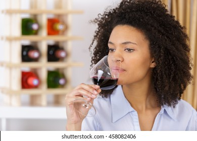 young woman with glass of red wine closeup