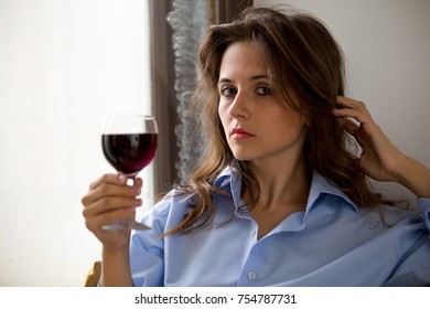 young woman with glass of wine in  morning