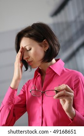 young woman with glasses have headache