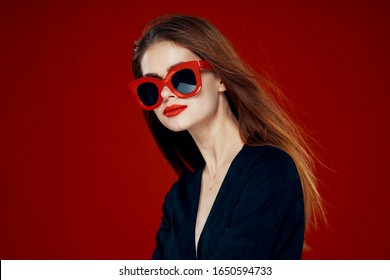 young woman in glasses isolated background