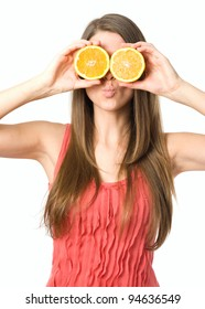 Young woman with glasses made with orange fruits