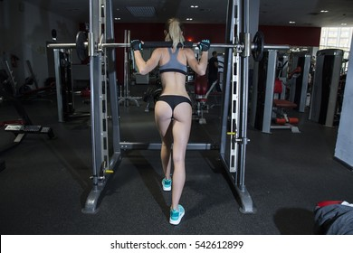 young woman goes in for sports at gym