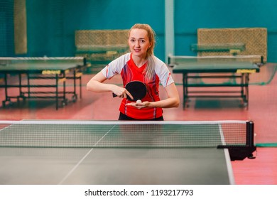 a young woman is going to make the filing in table tennis