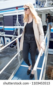 Young woman going out of the ferry