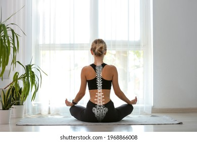 Young woman with good posture meditating at home, back view