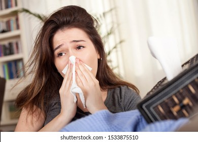young woman got flu and using paper