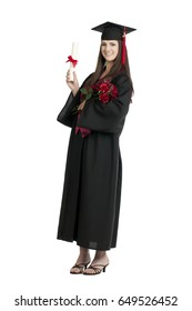 Young woman in graduation gown; isolated on white background
