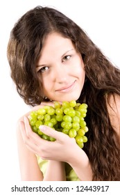 Young woman with grapes. Isolated on white.