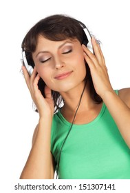 A young woman in a green shirt with headphones