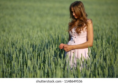 Young woman in green wheat field, outdoor, summeer, nature, copy space, countryside, provences