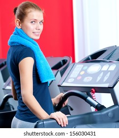 Young woman at the gym exerce. Jog on machine