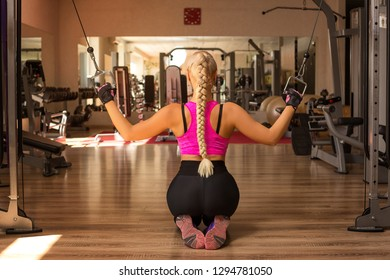 a young woman in the gym rocking the back