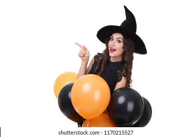 Young woman in halloween costume with balloons isolated on white background