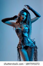 Young woman in Halloween costume posing in studio